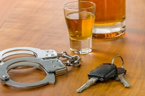Handcuffs, car keys and whiskey - DUI penalties NY